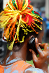 Port of Spain, Trinidad and Tobago: woman with colourful ropes on the hair - on the phone - carnival - photo by E.Petitalot