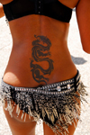 Port of Spain, Trinidad and Tobago: tattoo of a dragon on the back of a Trinidad girl - photo by E.Petitalot