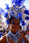 Port of Spain, Trinidad and Tobago: girl with white and blue feathers on the head during carnival - photo by E.Petitalot