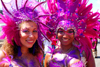 Port of Spain, Trinidad and Tobago: smiling girls with pink feathers - mulatto and white - carnival - photo by E.Petitalot