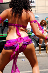 Port of Spain, Trinidad and Tobago: curly woman dancing during carnival - from behind - photo by E.Petitalot