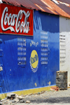 Scarborough, Tobago: drink advertising on wall - Coke and Carib beer - photo by E.Petitalot