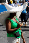 Port of Spain, Trinidad: woman wearing an immense sombrero hat for sun protection - photo by E.Petitalot