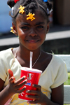 Port of Spain, Trinidad: a girl drinks a soda - photo by E.Petitalot