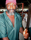 Trinidad - Port of Spain: a butcher and his machete - photo by P.Baldwin