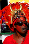 Port of Spain, Trinidad and Tobago: a man with devil head like a cap during carnival - African influence - mythology - photo by E.Petitalot