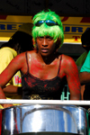 Port of Spain, Trinidad and Tobago: steelpan - drummer with green hair playing in a steelband during carnival - photo by E.Petitalot
