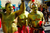 Port of Spain, Trinidad and Tobago: men in gold body painting celebrate carnival - photo by E.Petitalot