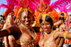Port of Spain, Trinidad and Tobago: revelers dance in the streets - women with colorful feather crown during carnival - photo by E.Petitalot