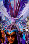 Port of Spain, Trinidad and Tobago: woman with colorful feather crown during carnival - the Big Yard - photo by E.Petitalot