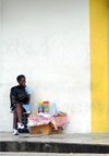 Trinidad - Port of Spain:street vendor - white wall - photo by P.Baldwin