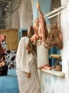 Tunisia / Tunisia / Tunisien - Keirouan: Arab lady at the halal butcher (photo by Miguel Torres)