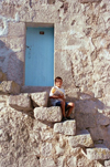 Turkey - Belisirma / Peristrema (Nevsehir province): boy sitting on stairs - village rupestre - photo by J.Kaman