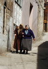 Gaziantep, South-Eastern Anatolia, Turkey: old women help each other - photo by C. le Mire
