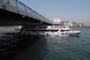 Istanbul, Turkey: boat under the Galata bridge - Golden Horn - Hali� - photo by M.Torres