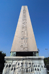 Istanbul, Turkey: Egyptian obelisk in the hippodrome - the base shows a relief from the old Constantinople - Eminönü District - photo by M.Torres