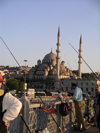 Turkey - Istanbul / Constantinople / IST: fishermen and the 'new' mosque / Yeni Cami / Yeni Valide - Eminonu waterfront - photo by R.Wallace