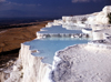 Pamukkale - Denizli province, Aegean region, Turkey: mineral springs of Pamukkale which contain calcium oxides left fantastic concretions on the travertine structures - photo by J.Fekete