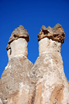 Cappadocia - G�reme, Nevsehir province, Central Anatolia, Turkey: fairy chimneys - hard rocks resting on cone-shaped pinnacles - Valley of the Monks - Pasabagi Valley- photo by W.Allg�wer