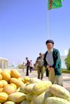 Turkmenistan - Ashghabat / Ashgabat / Ashkhabad / Ahal / ASB: melon day - old man and pile of melons - national holiday - fruit - photo by Karamyanc