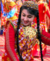 Turkmenistan - Ashgabat: happy dancer - Central Asian girl with long braids - photo by G.Karamyancr