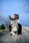 Turkmenistan - Boy and donkey (photo by G.Karamyanc)