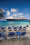 Grand Turk Island, Turks and Caicos: southwestern beach - deckchairs and Holland America cruise ship Prinsendam - photo by D.Smith