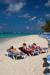 Grand Turk Island, Turks and Caicos: three women sunbathing on southwestern beach - photo by D.Smith