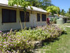 Funafuti atoll, Tuvalu: houses with flowers, papaya trees and rain water collection system - photo by G.Frysinger