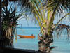 Funafuti atoll, Tuvalu: view of the lagoon side - boat and palm trees - photo by G.Frysinger