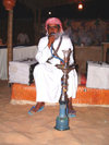 UAE - Dubai: smoking water-pipe at a Bedouin encampment / hookah / narghile / shisha / hubble-bubble - photo by Llonaid
