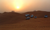 UAE - Dubai: dune bashing safari - sunset - jeeps - 4wds - dunes - photo by Llonaid