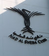 UAE - Dubai: CLub logo - Nad Al Sheba race course - photo by Llonaid