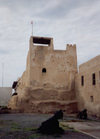 UAE - Ras al Khaimah / Ras al Khaymah / RKT : museum - watch tower of the former home of the ruling family - mud brick structure - photo by M.Torres