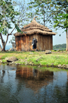 Jinja, Uganda: source of the Nile river at Lake Victoria, Napoleon gulf - wooden hut on Ripon Falls island, the falls themselves disappeared with the construction of Owen Falls Dam - photo by M.Torres