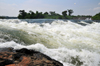 Bujagali Falls, Jinja district, Uganda: fast water flow on a step on the river Nile - seen from the Eastern bank - in 2012 the falls were submerged by the Bujagali Dam - photo by M.Torres