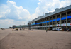 Entebbe, Wakiso District, Uganda: Entebbe International Airport - terminal building with empty air-bridge and executive jet on the apron - photo by M.Torres