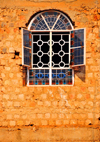 Kampala, Uganda: church window on Kikaya Hill - crude masonry wall - photo by M.Torres