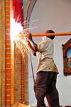 Kampala, Uganda: worker welding metal among a burst of sparks - St. Mary's Catholic Cathedral, Rubaga Cathedral, Rubaga hill - Metropolitan Archdiocese of Kampala - photo by M.Torres