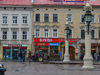 Lviv / Lvov, Ukraine: shops and imposing lamps - city centre - UNESCO World Heritage Site - photo by J.Kaman