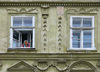 Lviv / Lvov, Ukraine: old lady looking out from window - photo by J.Kaman