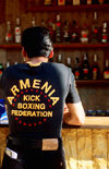 Odessa, Ukraine: young man standing at bar counter, rear view - jeans and t-shirt reading 'Armenia Kick Boxing Federation' - photo by K.Gapys