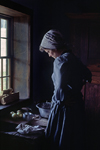Kettle Moraine State Forest, Wisconsin, USA: Old World Wisconsin - pioneer woman baking apple pie in a historic settler cabin - photo by C.Lovell