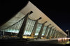 Dulles, Virginia, USA: Washington Dulles International Airport - main terminal at night - architect Eero Saarinen - the roof is a suspended catenary - IAD - photo by M.Torres