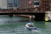 Chicago, Illinois, USA: Chicago River - the Ikanakya motor boat heads under the Clark Street Bridge - photo by C.Lovell