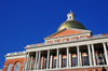 Boston, Massachusetts, USA: Massachusetts State House - elevated portico with Corinthian columns - red brick walls, white pillars and trim, and golden dome catching the sun - photo by M.Torres