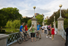 Boston, Massachusetts, USA: bicyclists on the suspension bridge in the Boston Common - photo by C.Lovell