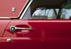 USA: door detail of a 1957 red Ford Thunderbird - vintage car - photo by C.Lovell