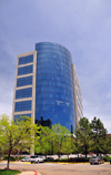 Denver, Colorado, USA: Regency Plaza, Class AA office tower - curved blue glass curtain wall in a granite and chrome façade - Michael Barber Architecture - South Ulster Street - Denver Technological Center / DTC - photo by M.Torres
