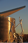 Denver, Colorado, USA: Colorado Convention Center admired by the figures of the sculpture 'Dancers' by Jonathan Borofsky - Speer Boulevard - photo by M.Torres